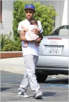 Bow Wow holding baby Shai at Cross Creek