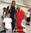 NBA star Kevin Durant, center, DJ Kenny Burns, right and son