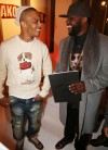 T.I. gifts Rico Love with Book of Kings Vol. 1
