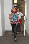 Rita Ora arrives at LAX and changes clothes