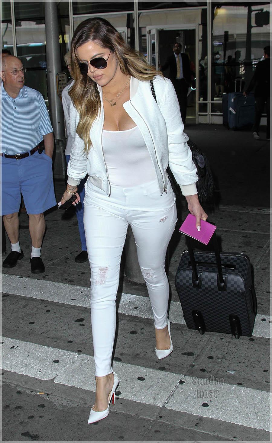 Khloe Kardashian arrives at John F. Kennedy International Airport (JFK) following sister Kim's wedding