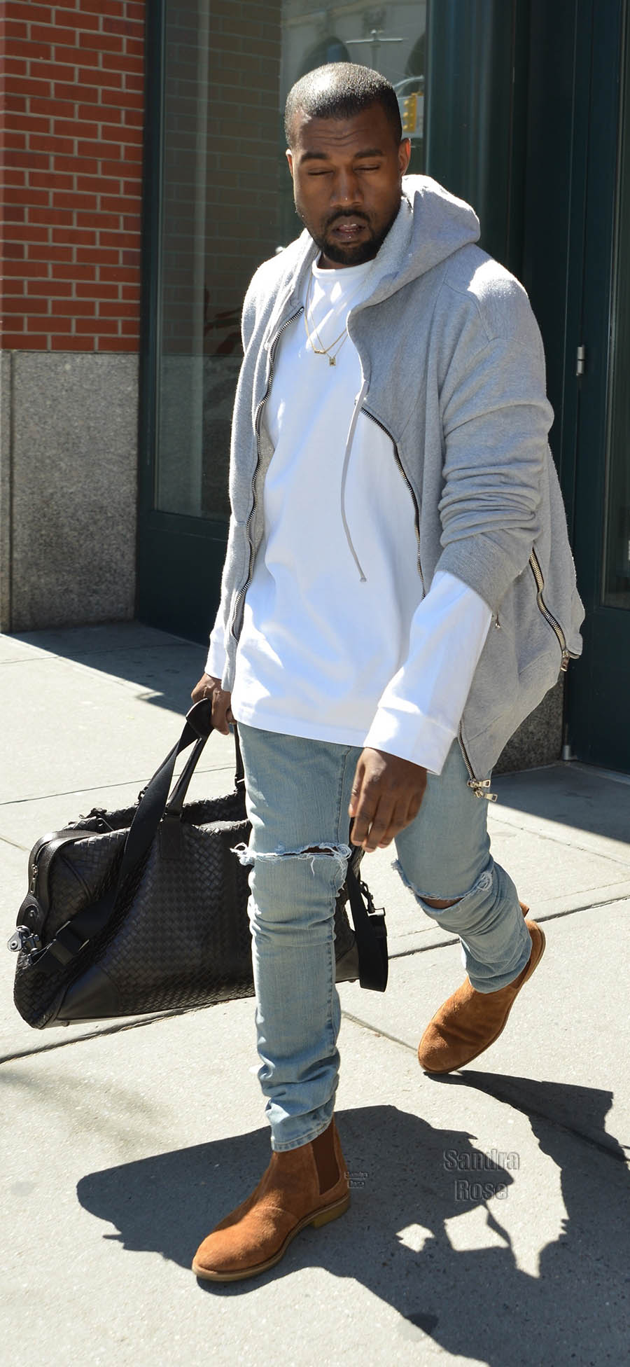 Kanye West leaving his apartment in New York