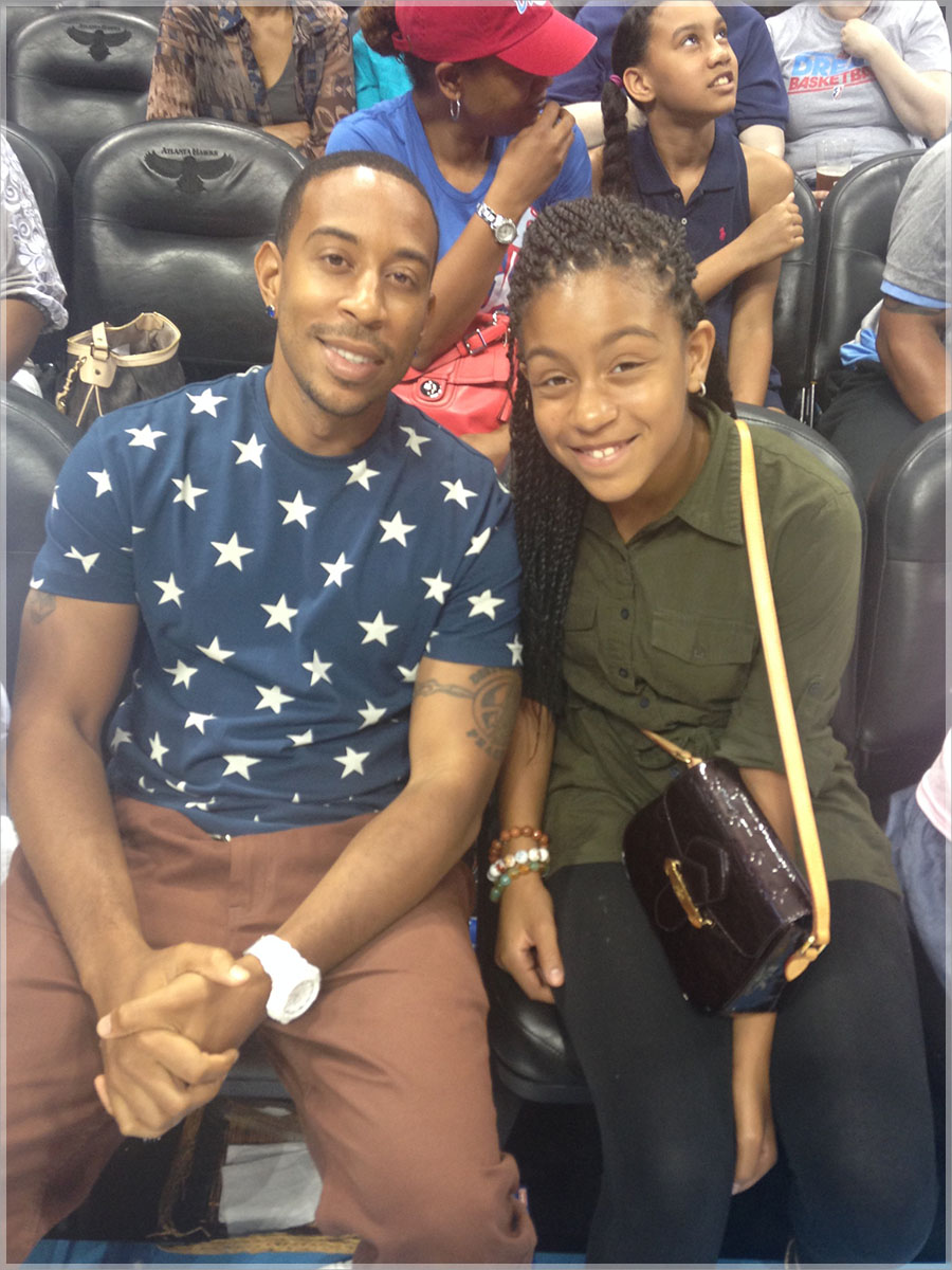 Ludacris and daughter Karma at Atlanta Dream