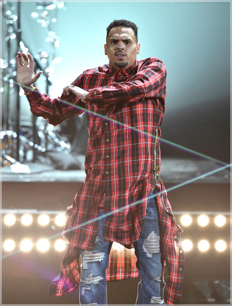 Chris Brown wearing custon plaid extended button shirt dress