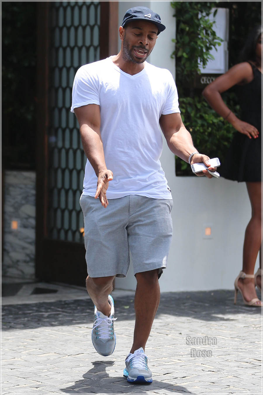 Tim Witherspoon spotted out while Kelly Rowland goes shopping