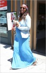Kelly Rowland shows off her baby bump as she picks up some juice