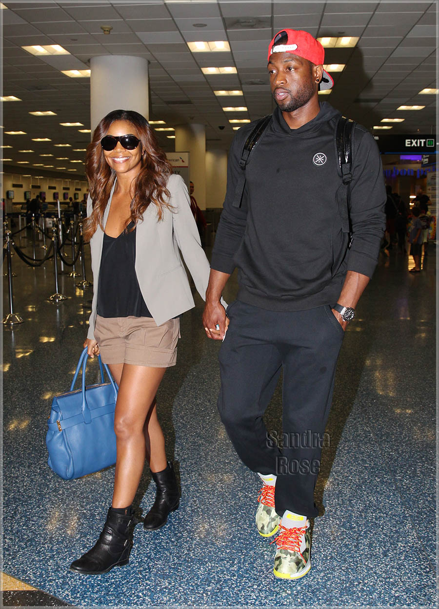 EXCLUSIVE: Dwyane and Gabrielle Wade take off on their honeymoon