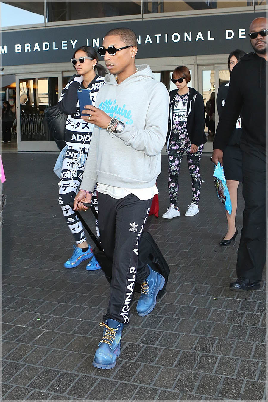 Pharrell Williams arrives a Los Angeles International Airport