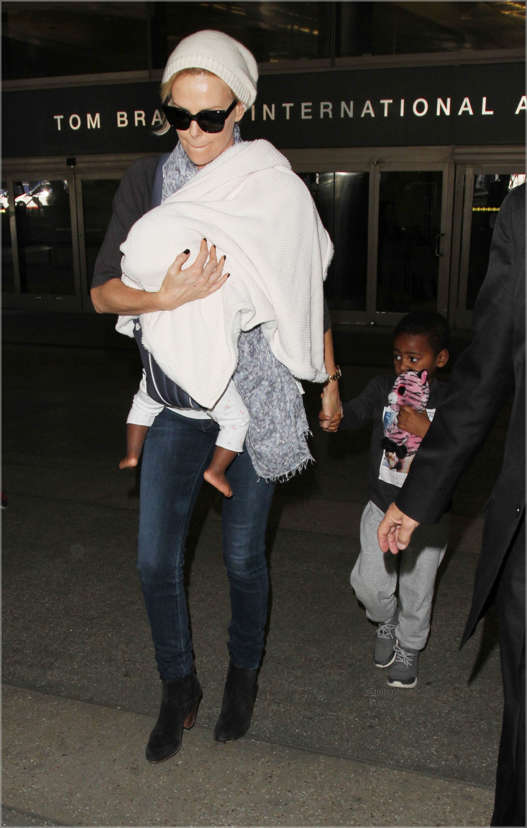 Charlize Theron arrives on a flight to Los Angeles International Airport