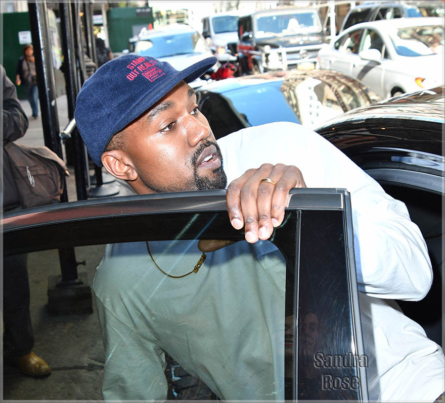 Kanye West leaving a hotel in Soho