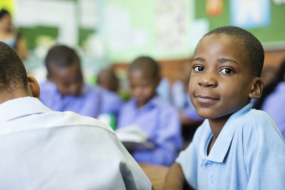 Schoolboy smiling in class