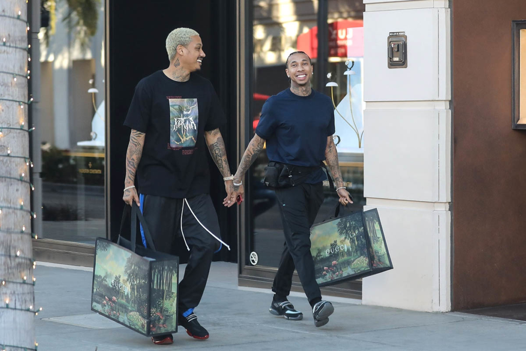 tyga looks happy after dropping some dough at gucci with