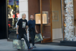 Tyga shops at Gucci with his partner