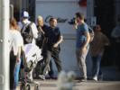 Tyga shops at Gucci with his partner