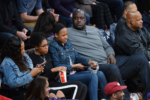 Shaquille O'Nea and family at Lakers vs Warriors game