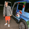 Justin Bieber stops to chat with photographers after leaving Selena Gomez's house