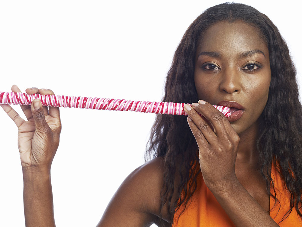 Woman Eating Stick of Candy