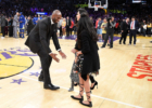 Kobe Bryant runs after his family at halftime after both his #8 and #24 Los Angeles Lakers jerseys are retired