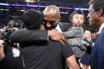 Kobe Bryant hugs Allen Iverson at halftime after both of Bryant's #8 and #24 Los Angeles Lakers jerseys are retired