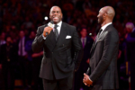 Earvin 'Magic' Johnson addresses the crowd before Kobe Bryant has his #8 and #24 Los Angeles Lakers jerseys retired
