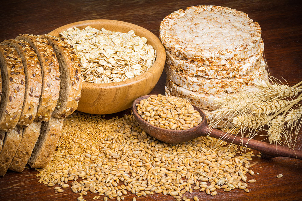 Whole wheat grains, bread, oats and flax seed