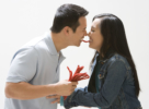 Asian couple eating licorice