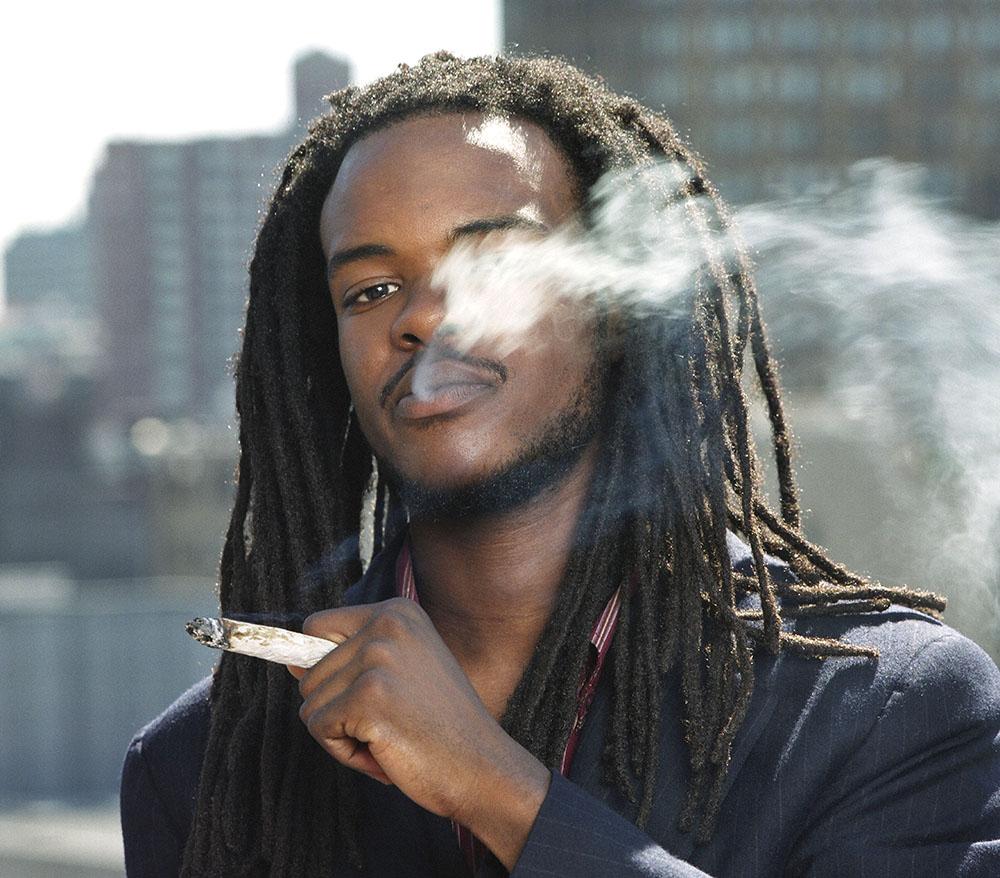 African man smoking marijuana