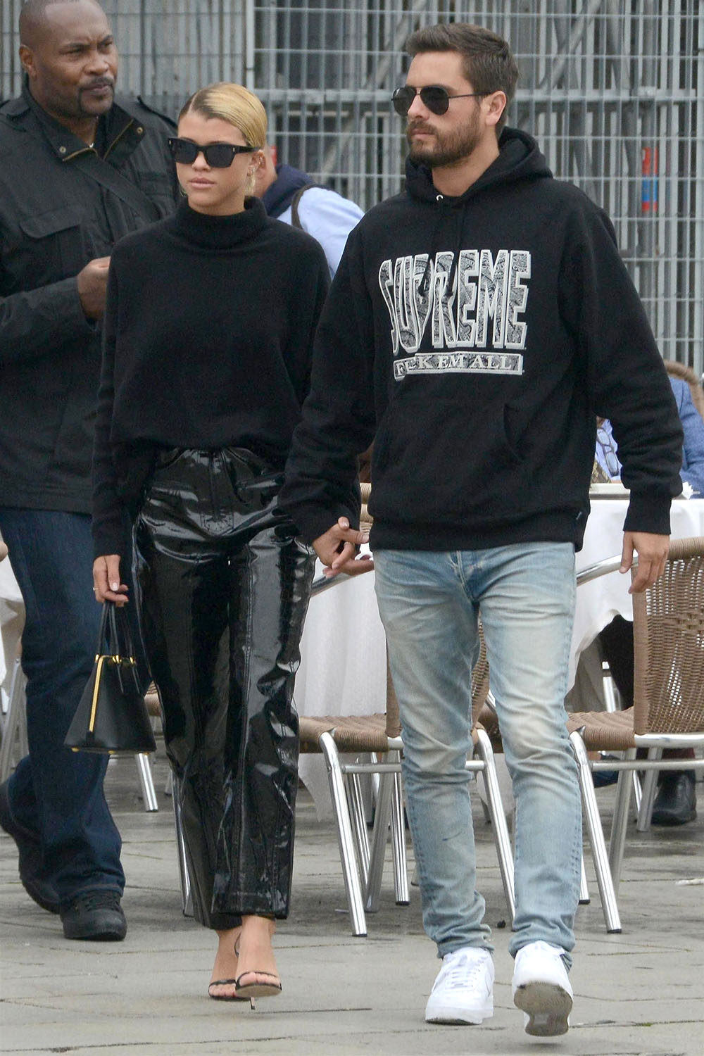 Sofia Richie and her boyfriend Scott Disick hold hands in Italy
