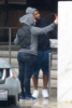 Usher braves the rain to shop for shoes in Beverly Hills