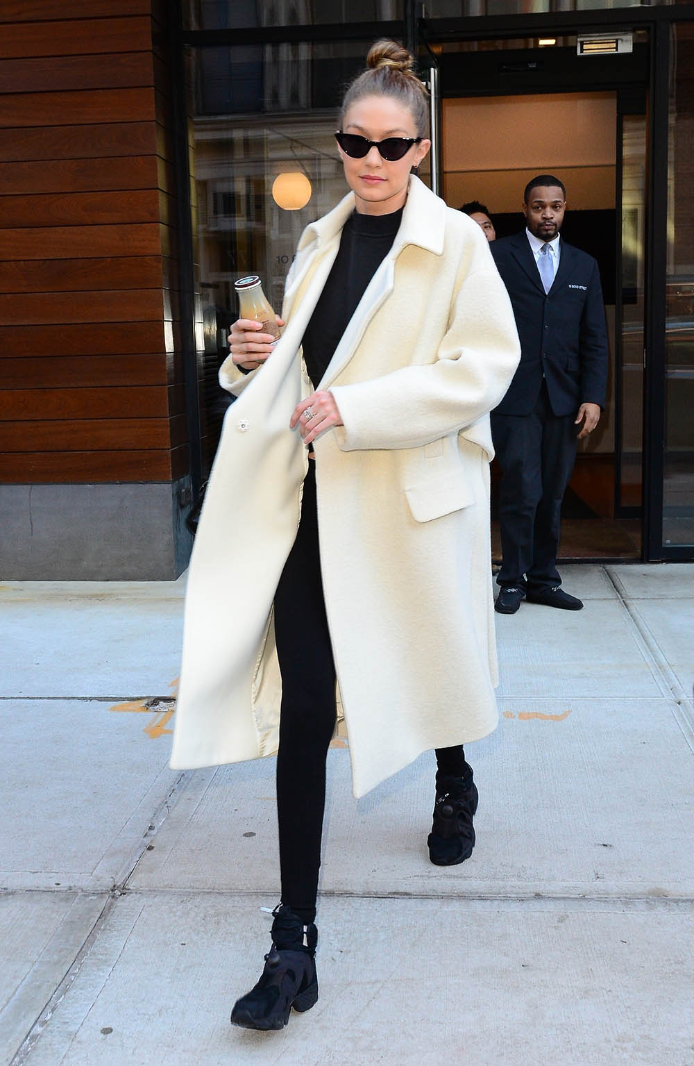 Gigi Hadid wears white alpaca wool coat in New York