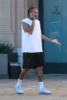 Tyga looked casual as he leaves Barneys New York with a friend