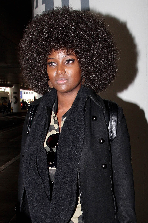 amara la negra arrives in la with her afro wig in full
