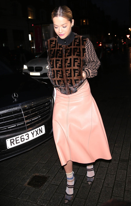 British singer Rita Ora at a Radio Appearance in London, wearing a Fendi fur bomber