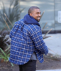 Kanye West arrives at his Calabasas office in a happy mood