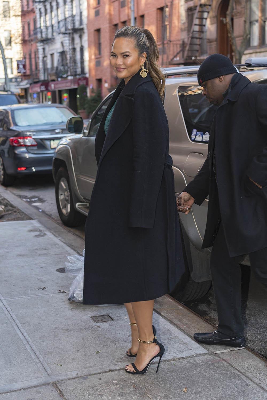 Chrissy Teigen arrives back home in NYC