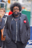 Questlove plays drums on the sidewalk in Tribeca
