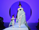 Coco Rocha and her daughter Ioni walk for Jean-Paul Gaultier