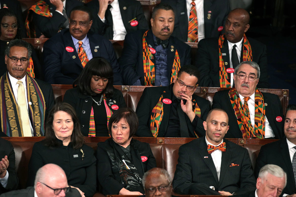Members of Congress wear black clothing and Kente cloth in protest before the State of the Union address