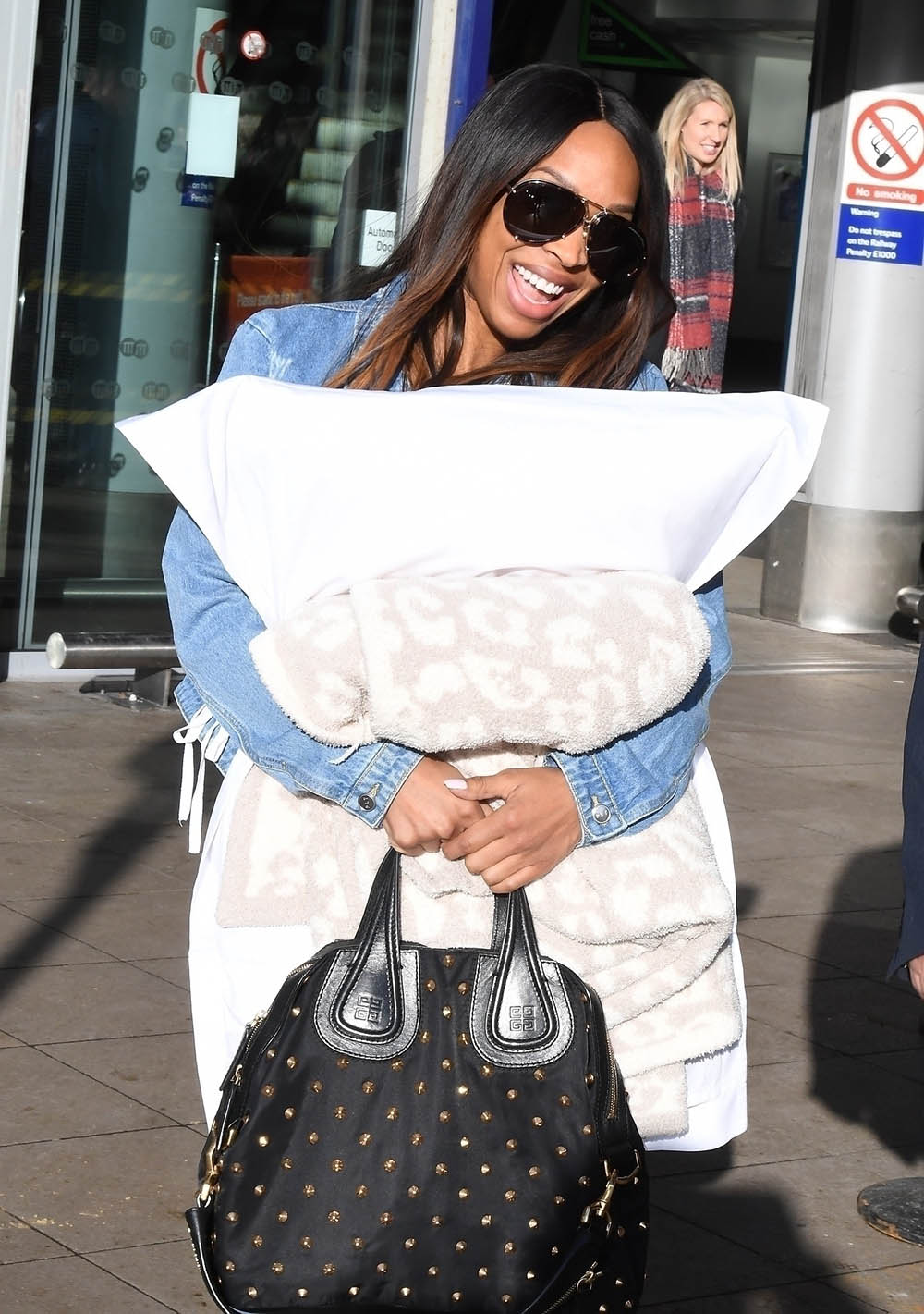 Malika Haqq seen arriving at Manchester Piccadilly Train Station