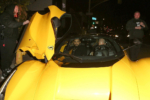 Drake hops into his $7 million Yellow Ferrari