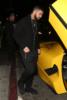 Drake hops into his $7 million Yellow Ferrari