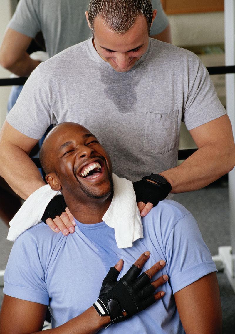 Man in Gym Massaging Shoulders