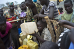 South Sudanese Refugees collect and drink water at a well