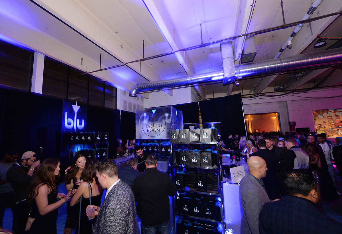 Guests hang out in the blu Tasting Room during The 2018 Maxim Party Co-Sponsored By blu