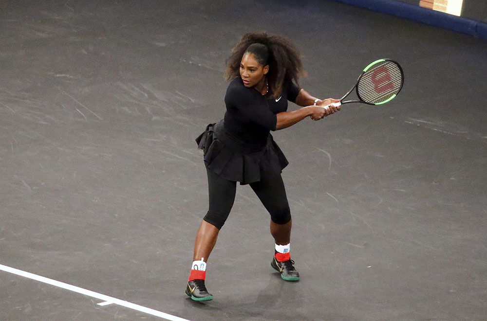 Serena Williams plays against Venus in the tennis tournament in New York City