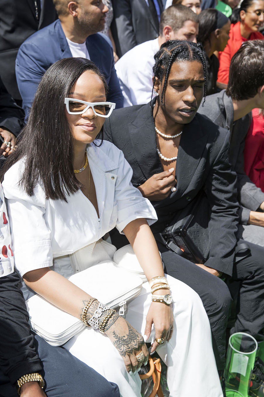 rihanna and rapper a ap rocky sit front row at louis