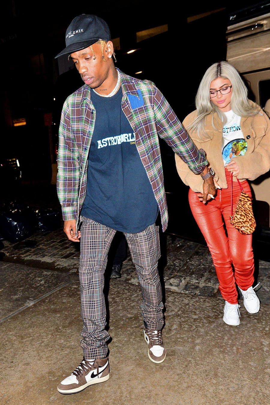 5f1bdca57ad6 Travis Scott and Kylie Jenner are spotted exiting their limo after  attending Travis' Astroworld concert at Madison Square Garden in New York.