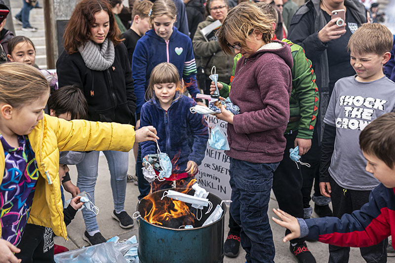 Idaho children burn surgical masks GettyImages 1231559297